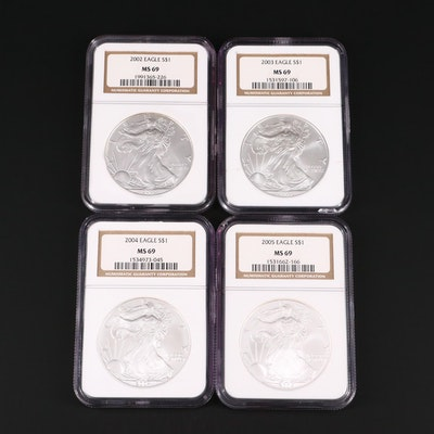 Four NGC Graded MS69 American Silver Eagles, 2002 to 2005