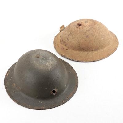 WWII British Brodie Style Steel Battle Worn Helmets, circa 1940s