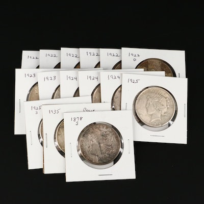 Fourteen Peace Silver Dollars and a Morgan Silver Dollar