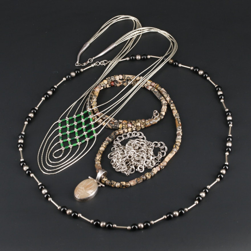 Gemstone Necklace Assortment Featuring Scarab Pendant and Liquid Silver Necklace