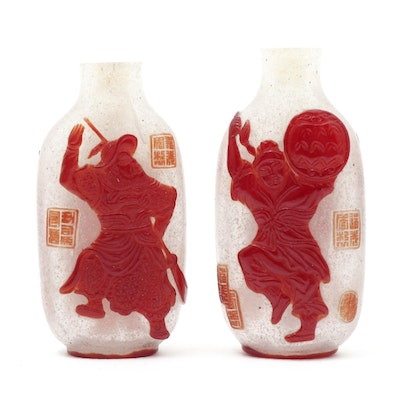 Pair of Chinese Red Overlay Bubble-Suffused Peking Glass Snuff Bottles