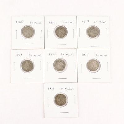 Seven U.S. Three-Cent Nickel Coins
