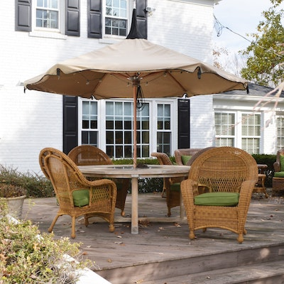 Frontgate Teak Patio Table with Wicker Armchairs and Tuuci Umbrella