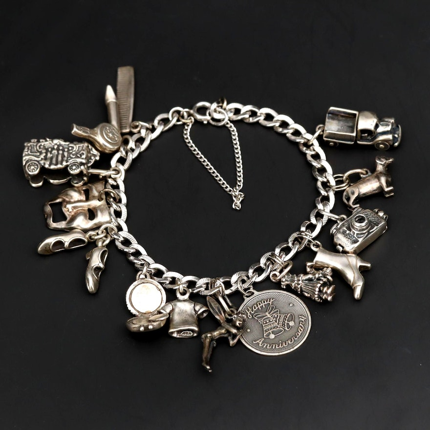 Charm Bracelet With Sterling Silver Charms Including Fairy and Circus Cart