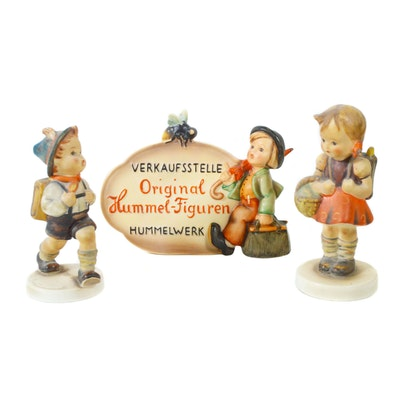 "I.M. Hummel ""School Girl"" and ""School Boy"" Figurines, with Porcelain Dealer Sign"