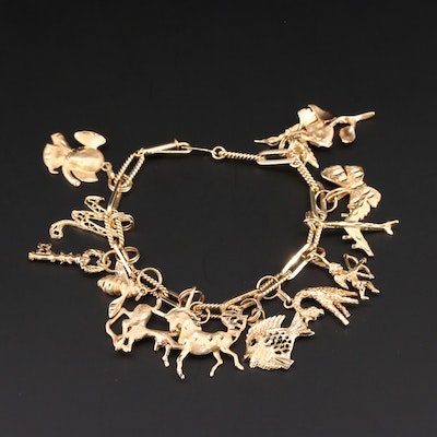 14K Yellow Gold Charm Bracelet Including Horse, Fish, Elephant and More