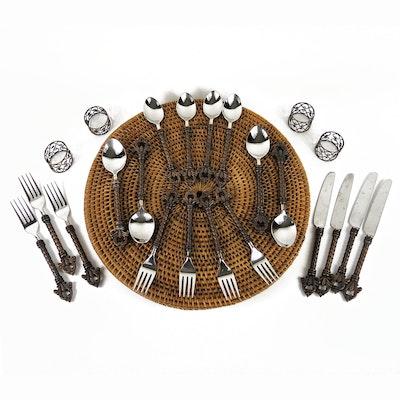 Stainless Steel and Bronze-Finish Fleur-de-Lis Flatware and Woven Placemats