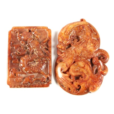 Chinese Carved Burnt Sienna Soapstone Pendants with Dragon Motifs