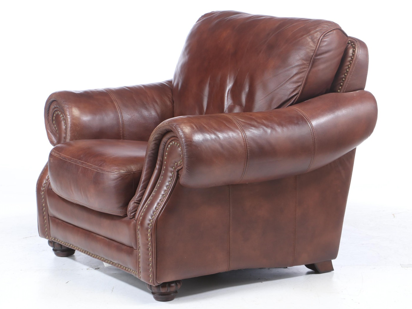 Bassett Leather Arm Chair With Nail Tack Detailing And