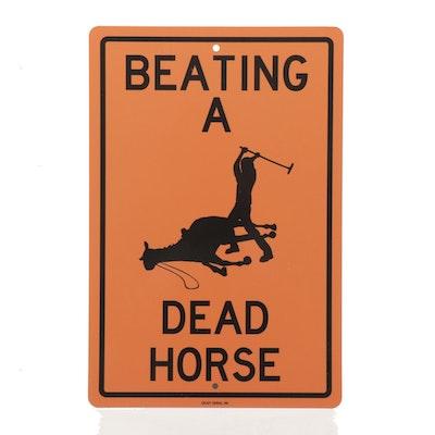 "Enjoy Denial Inc. Metal Sign ""Beating A Dead Horse"""