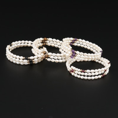 Cultured Pearl, Garnet, Amethyst, and Tiger's Eye Wrap Bracelets.