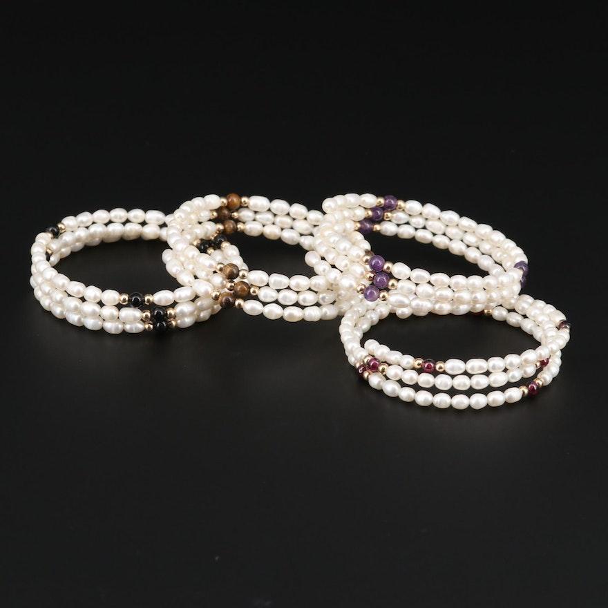 Cultured Pearl, Garnet, Amethyst, and Tiger's Eye Wrap Bracelets.