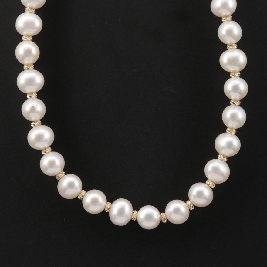 Strand of Pearls with 14K Yellow Gold Spacer Beads and Closure