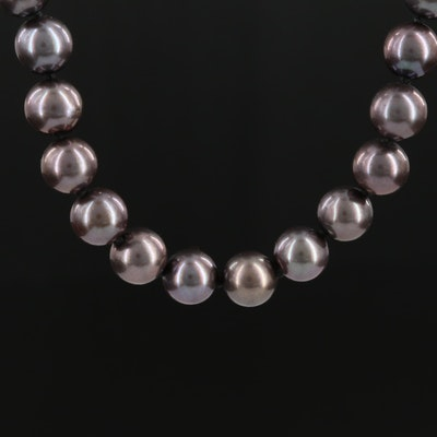 Knotted Strand of Black Pearls with 14K Yellow Gold Clasp