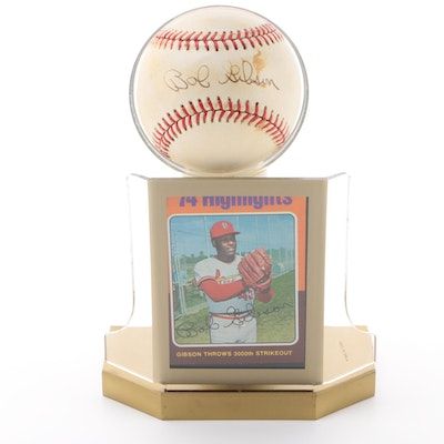 Bob Gibson Signed National League Baseball with a 1975 Topps Card   COA