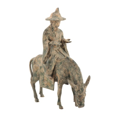 East Asian Polychromed Cast Iron Scholar Riding a Donkey Figure