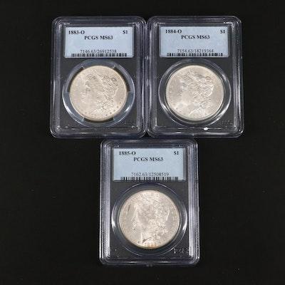 Three PCGS Graded MS63 Silver Morgan Dollars Including an 1883-O