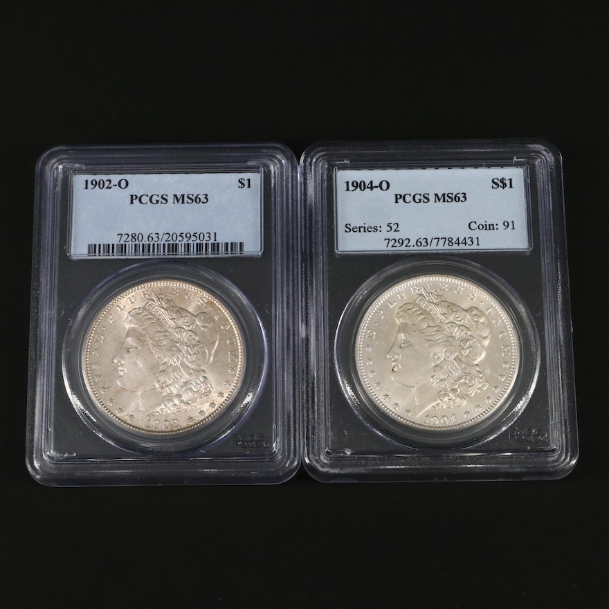Two PCGS Graded MS63 Silver Morgan Dollars Including a 1902-O and 1904-O
