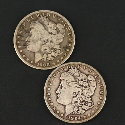 Two Silver Morgan Dollars Including an 1888 and 1904