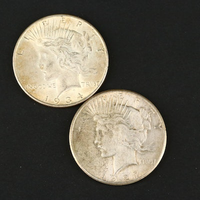 Two Silver Peace Dollars Including the Following: 1927 and 1934-D