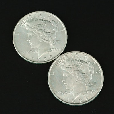 Two Silver Peace Dollars Including a 1923 and 1924