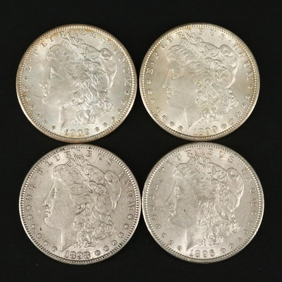 Four Silver Morgan Dollars Including an 1896, 1898, 1899-O, and 1902-O