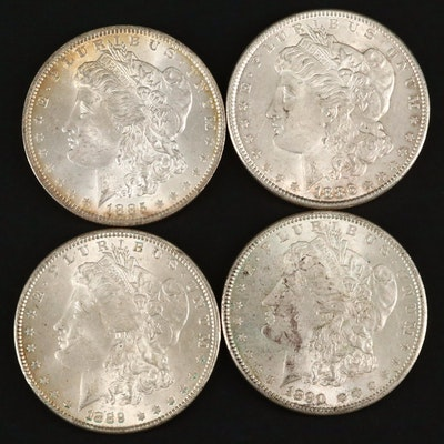 Four Silver Morgan Dollars Including an 1885-O and 1890
