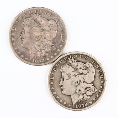 Two Silver Morgan Dollars Including 1878 Carson City and 1883-S