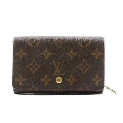 Louis Vuitton Porte Tresor Compact Bifold Wallet in Monogram Canvas and Leather