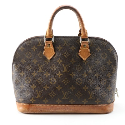 Louis Vuitton Alma Handbag in Monogram Canvas and Leather