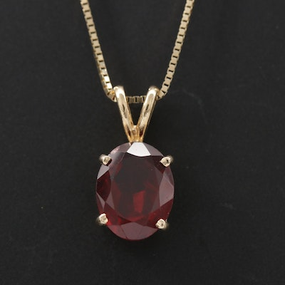 10K Garnet Pendant Suspended From a 14K Box Chain Link Necklace