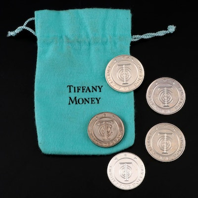 "Tiffany & Co. ""Tiffany Money"" Sterling $25 and $50 Tokens"
