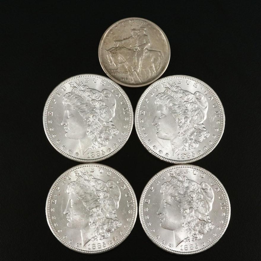 Four 1885-O Morgan Silver Dollars and a Stone Mountain Silver Half Dollar