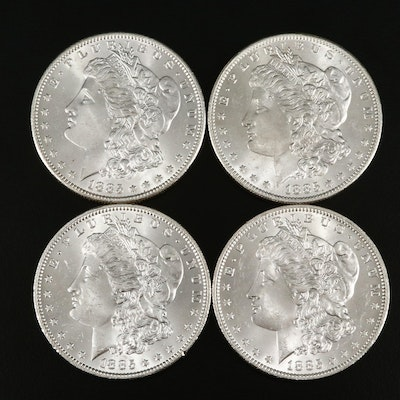 Four Uncirculated 1885-O Morgan Silver Dollars
