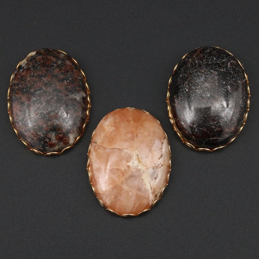 Selection of Framed Gemstones Including Garnet, Quartz, and Garnet in Quartz