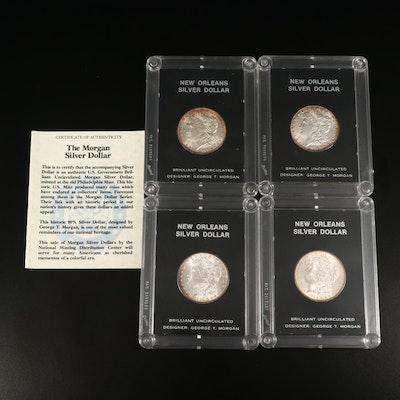 Four 1884-O Morgan Silver Dollars