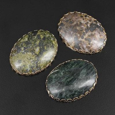 Framed Oval Verde Antique and Jasper Cabochon Mineral Specimens