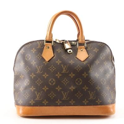 Louis Vuitton Alma Handbag in Monogram Canvas and Vachetta Leather
