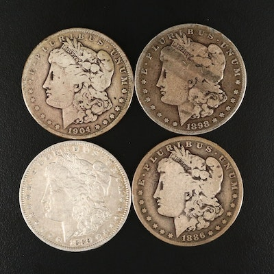 Four Silver Morgan Dollars Including an 1886-O, 1889-O, 1898-S, and 1904