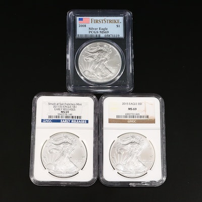 Three Graded One Dollar U.S. Silver Eagles Including a PCGS Graded MS69 2008