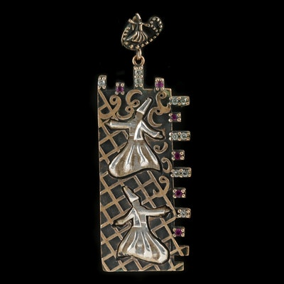 Whirling Dervish Sterling Silver Cubic Zirconia and Ruby Pendant