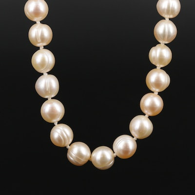 Strand of Pearls with 14K Yellow Gold
