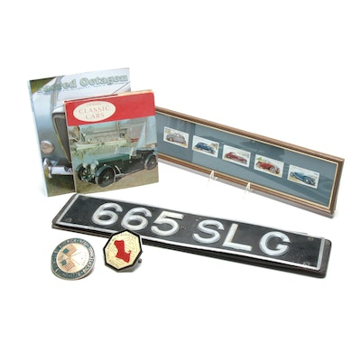 Classic Vintage Car Collection Featuring Emblems and License Plate