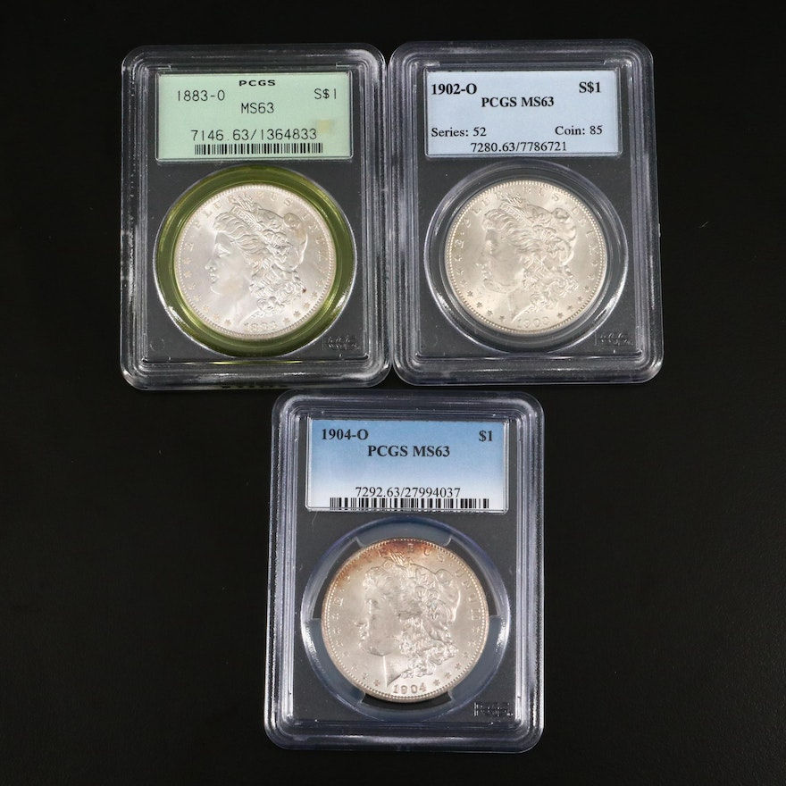 1883-O, 1902-O, and 1904-O PCGS Graded MS63 Silver Morgan Dollars