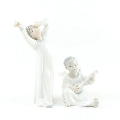 "Lladró Porcelain Figurines ""Angel Figurine"" and ""Boy Awaking"""