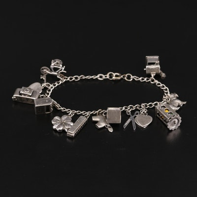Vintage Sterling Silver Enamel Charm Bracelet Featuring Articulating Charms