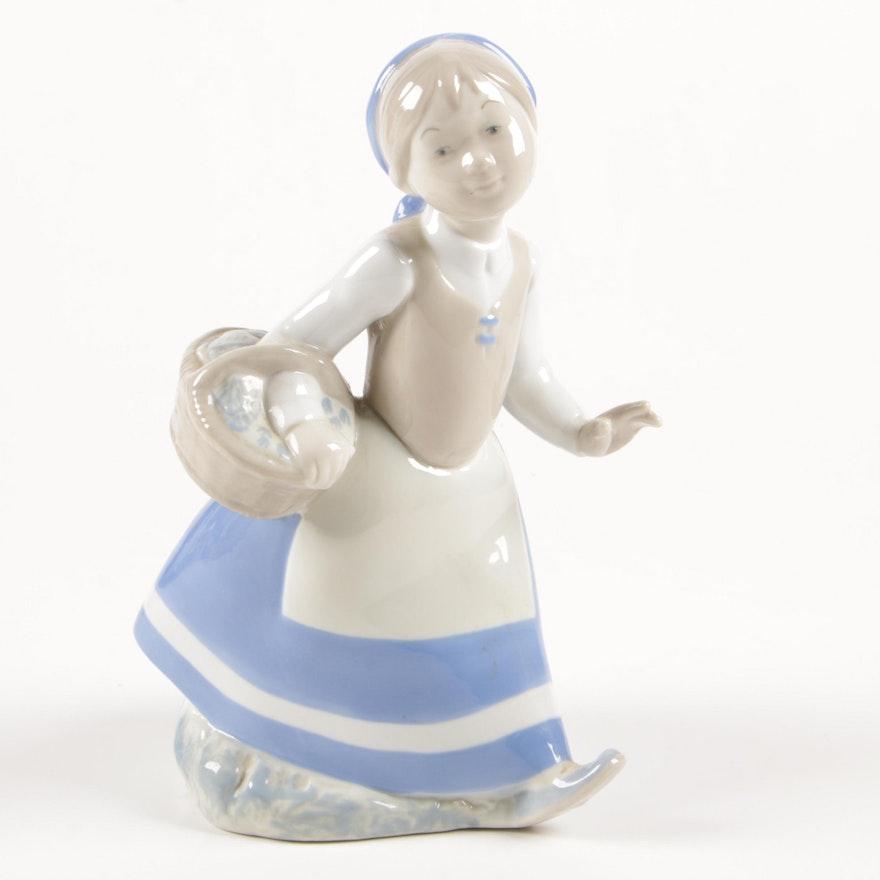 Rex Valencia Porcelain Figurine of Girl with Flower Basket