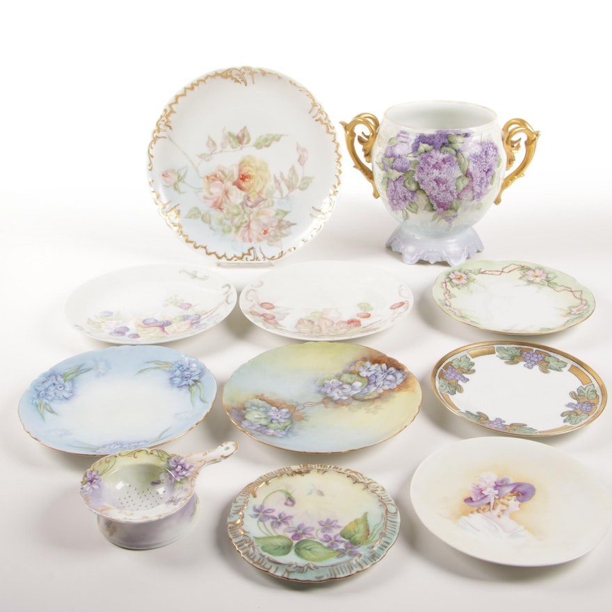 Continental Hobbyist Painted Porcelain Plates, Urn, and Tea Strainer