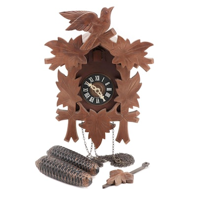 West German Wood Carved Cuckoo Clock With Pinecone Weights, circa 1970s-1980s