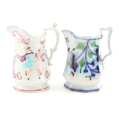 English Gaudy Ironstone and Luster Dancing Couple Jugs Mid-19th Century